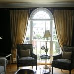 Divide your curtains for a larger feel